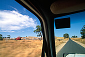 View from a jeep at landscape under blue sky, Pyrenees Highway, Avocao, Australia