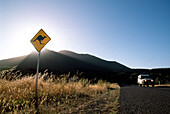 Road Sign and lonesome jeep under a blue sky at Grampians National Park, Australia