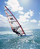 A sail boarder on the sea in the sunlight, Boa Vista, Cape Verde, Africa