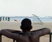 Maneuver, Army training on the beach, Teenager watching, Baia da Gatas, Sao Vicente, Cape Verde Islands