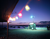 Bar with set of lights at the old pier, Twilight, Sal Rei, Boa Vista, Cape Verde Islands