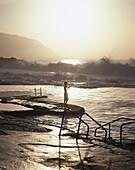 Boy angling on sea water pool, El Hierro Canary Islands, Spain