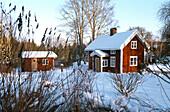 Sommer house in a winter landscape, South of Boras, Vastergotland, Sweden
