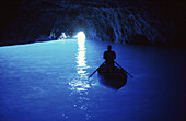 Person in a rowing boat in the Blue Grotto, Capri, Campania, Italy, Europe