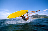 Windsurfer at the Pata Negra Surf Center, Strong winds, Playa Los Lances, Tarifa, Costa de la Luz, Andalusia, Spain