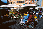 Girl friends on a moped at the market place, Campo de Fiori, Rome, Italy, Europe