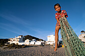 Children playing football on the beach, Football goal made from a fishing net, Zahara de los Alunes, Costa de la Luz, Andalusia, Spain