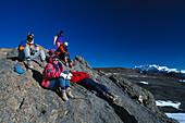 Mountaineers resting at Gilman´s Point under blue sky, Kibo, Kilimanjaro Tansania, Africa