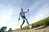 Girl doing nordic walk, wellness sports