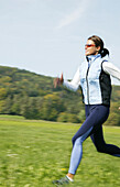 Mid adult woman jogging, Styria, Austria
