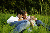 Family in nature, Family in nature, Family sitting in green meadow, Family Nature People Lifestyle