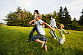Family running in nature, Family running in nature, Family running through green meadow, Family Nature Lifestyle People