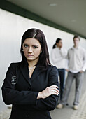 Buisness-woman looking at camera, two people in background, Business, Austria