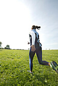 Girl jogging in nature, Girl jogging in nature, Women jogging in nature, sports wellness