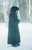 Nun standing in the snow, Omsk, Siberia