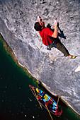 Free Climbing on Rock Face above Lake Wolfgangsee, Austria