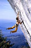 Harald Berger, Gitschenwand, Young man climbing up Gitschenwand, Salzburger Land, Austria , Harald Berger, Sportklettern Salzburg, Austria