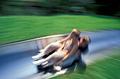 Young couple on summer toboggan run, Strobl, Salzburg (state), Austria