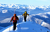 Two alpinists moving up on ridge, Angerstein, Gosaukamm, Austria
