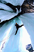 Man climbing in an ice cave, Golden Area, Banff National Park, Canada