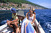 Teenagers on a boat near Hvar Island, Hvar, Croatia