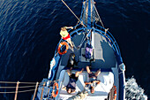 Relaxing on sailing boat, Kalymnos, Greece