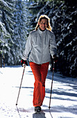 Female nordic walker in snowy wood, Nordic Walking, Muehlviertel, Upper Austria
