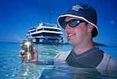 Man with Fiji Gold Beer, Blue Lagoon Cruise Nanuya Lailai Island, Fiji