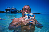 Man with Fiji Export Beer, Blue Lagoon Cruise Nanuya Lailai Island, Fiji