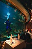 Diver in the aquarium, Al Mahara Fish Restaurant, Burj Al Arab Hotel, Dubai, United Arab Emirates