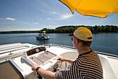Skipper on Houseboat, Skipper on houseboat, Crown Blue Line Houseboats, Lake Zotzensee, Mecklenburgian Lake District, Germany
