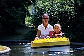 Mother and Child in a Lego Boat, Legoland, Billund, Central Jutland, Denmark