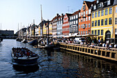 Nyhavn Sightseeing Boat, Old houses, boats and Cafés along the Nyhavn Canal, Copenhagen, Denmark