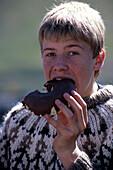 Boy enjoying Pastry, Isafj?rdur, Iceland