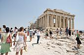 Tourists in front of the Parthenon, Acropolis Athens, Greece