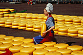 Woman in traditional clothes selling cheese, Cheese Market, Alkmaar, Netherlands