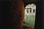 Donna Leon, Death in a Strange Country, View through an alleyway, Calle Cocco, Venice, Italy