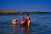 Children playing in the lake with a rubber ring, Mueritz beach, Mecklenburg Lake District, Mecklenburg-Vorpommern, Germany