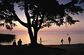 People on lakefront, Muritz Lake, Mecklenburg Lake District, Mecklenburg-Western Pomerania, Germany