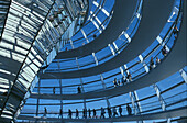 Reichstag, visitors inside glass dome, low angle view, Berlin, Germany