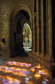 Reflection of light through stained glass windows, Notre Dame de Roscudon, Brittany, France
