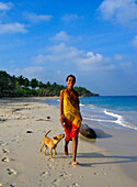 Girl and Dog walking on the Beach, Carribbean Beach, Cartagena, Colombia, South America