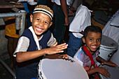 Laughing boys drumming at carnival in the evening, Pelourinho, Salvador da Bahia, Brazil, South America