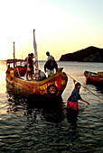 Fishermen in a boat coming back from fishing, Taganga, Santa Marta, Colombia, South America