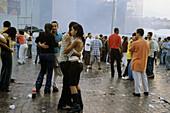 Teenagers dancing and standing on a square at Festas Juninas, Caruaru, Sao Juao, Brazil