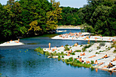 People sunbathing nude at the banks of the river Isar, Flaucher, Munich, Bavaria, Germany, Europe
