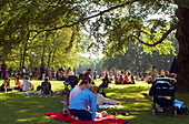 Sunday Picnic of young family on the green in the English Garden, Munich, Bavaria, Germany