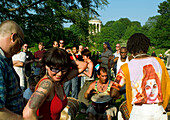 People drumming and dancing in the English Garden, Munich, Bavaria, Germany