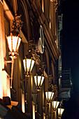 Lanterns on the fascade of a building at Max Joseph Platz, Munich, Bavaria, Germany