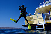 Diver jumping into the water, Blue Water Diving School, Hurghada, Egypt, Africa